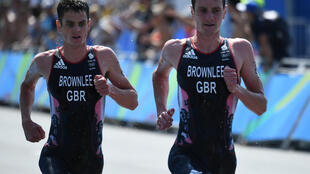 Alistair Brownlee (R)will delay a career move to run in the delayed Tokyo Olympics next year as he bids for a third successive triathlon title, with younger brother Jonny (L) again set to be a major rival