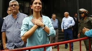 Venezuela's opposition leader Maria Corina Machado arrives to state prosecutor office in Caracas, 3 December 2014.