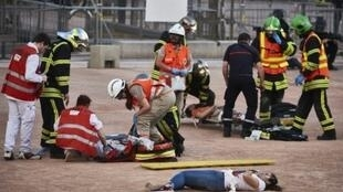 Police and emergency workers take part in a mock suicide attack exercise as part of security measures for the upcoming Euro 2016 in Lyon, France