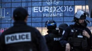 Policemen take part in a security exercise ahead of the Euro 2016 at the Parc Olympique Lyonnais stadium