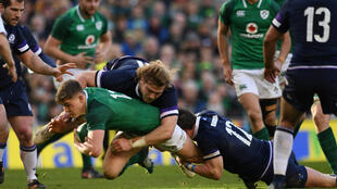 Ireland's Garry Ringrose in action with Scotland's Peter Horne and David Denton