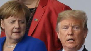 La chancelière allemande Angela Merkel et le président américain Donald Trump, au début du sommet de l'OTAN à Bruxelles, le 11 juillet 2018.