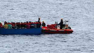"Migrants on a wooden boat are rescued by German NGO Jugend Rettet ship ""Juventa"" crew in the Mediterranean sea off Libya coast on June 18, 2017."