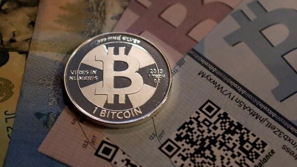 One of Bitcoin enthusiast Mike Caldwell's coins in this photo illustration at his office in Sandy, Utah, from September 17, 2013.