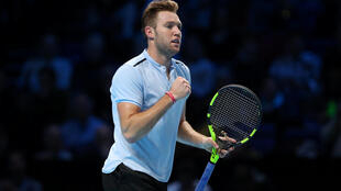 Jack Sock came from a set down to win his first match at the ATP Finals.