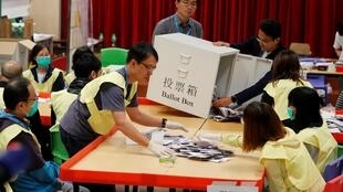 Vote counting at a polling station in Hong Kong after local elections, 24 November, 2019.