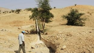 A dried out gulley near the West Bank city of Jericho
