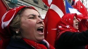 Franco -Turkish protesters demonstrate near the Senate in Paris ahead of a vote on a bill on the Armenian genocide