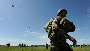 900 paratroopers drop from the sky above Sainte-Mere-Eglise on 8/6/2014.