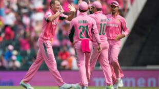 South Africa's Chris Morris celebrates after taking the wicket of India's Virat Kohli.