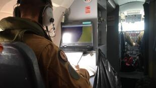 A bord du Falcon, un marine en mission de police des pêches au large des côtes sénégalaises.