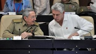 Cuban President Raul Castro (L) and First Vice president Miguel Diaz-Canel talking during the Permanent Working Committees of the National Assembly of the People's Power in July 14, 2017.
