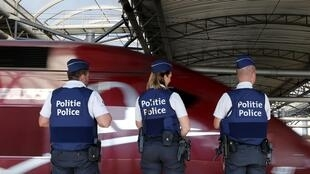 Belgian police officers stand guard on a platform at the Thalys high-speed train terminal at Brussels Midi/Zuid railway station, August 22, 2015.