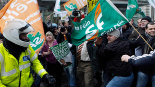 Sinn Fein demonstrators clash with police officers after breaking through the gates of Government Buildings in Dublin