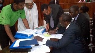Hussein Khalid (in green) of Haki Africa and Khelef Khalifa (in white) of Muslims for Human Rights in court, April 2015