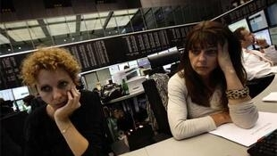 Share traders during mid-day trading at Frankfurt's stock exchange on Tuesday