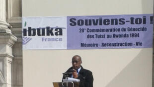 Marcel Kabanda, president of the genocide survivors group Ibuka, speaks at the Paris commemoration