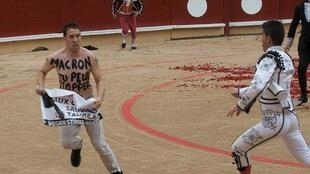 An anti-bullfighting protester with the words written on his chest in French, 'Macron (referring to the French President Emmanuel Macron) you can stop this'n Aug 15, 2017.