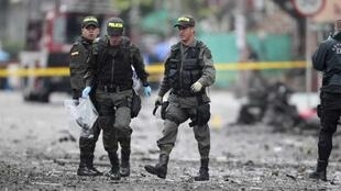 Bomb squad members at the scene of the blast