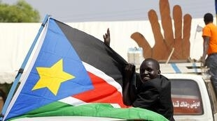 A Sudanese man cheers during a demonstration in support of the referendum on southern independence during a rally in Juba