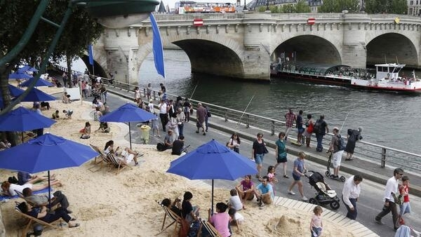 Paris Plages on the banks of the River Seine  - soon participatns should be able to swim as well as sunbathe