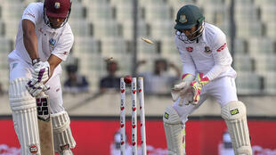 West Indies' Kieran Powell is bowled out during the second day of the second Test cricket match between Bangladesh and West Indies in Dhaka on December 1, 2018.