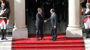 Watch out for hackers! Nicolas Sarkozy welcomes François Hollande to the Elysée after last year's presidential election