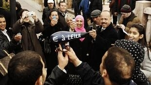 Protesters mocking Leila Ben Ali, who worked as a hair stylist. She allegedly left the country with 1.5 tonnes of gold.