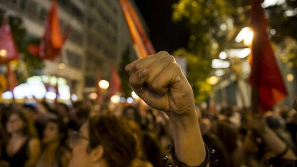 Supporters of the 'No' vote celebrate their victory in the city centre of Athens, 5 July 2015