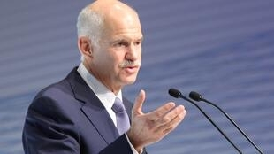 Greek Prime Minister George Papandreou addresses a conference of German business leaders