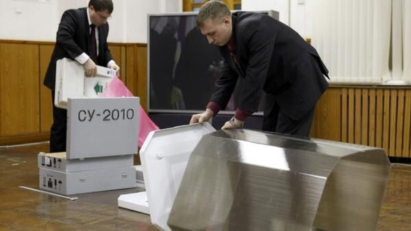 Workers put together ballot boxes during a demonstration for journalists, organised by the local election commission