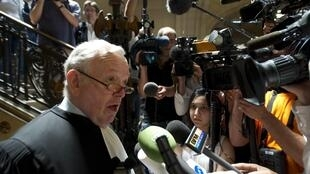 Olivier Metzner faces the press during the trial of Manuel Noriega