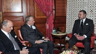 Morocco's King Mohamed VI (R) with French Prime Minister Jean-Marc Ayrault  (C) and Foreign Affairs Minister Laurent Fabius
