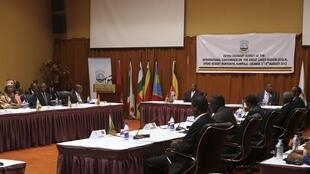 Uganda's President Yoweri Museveni (back C) chairs the International Conference on the Great Lakes Region