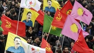 Demonstrators carry red flags and Ocalan's portrait on their protest in Strasbourg on Saturday