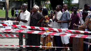 Voters stand in line to cast their votes at a polling station in Kinshasa, Democratic Republic of Congo, December 30, 2018.
