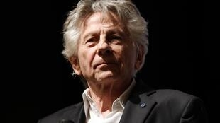 "In this file photo taken on November 04, 2019 French Polish director Roman Polanski looks on on stage after the preview of his last movie ""J'accuse"" (An Officer and a Spy) in Paris"