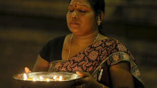 Sri Lankan Tamil woman praying, Colombo, 2015. Many Sri Lanka Tamils displaced by the long civil war have been able to return home.