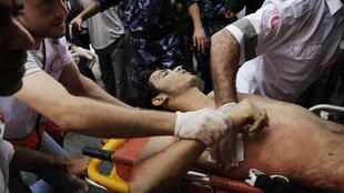 An injured Palestinian is rushed to hospital in Khan Younis in the north of the Gaza Strip