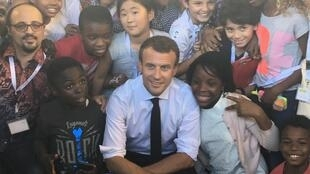 French President Emmanuel Macron poses with students from the Louis Pasteur secondary school in Lagos, Nigeria, 04 July 2018