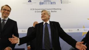 European Central Bank President Jean-Claude Trichet with Bundesbank President Jens Weidmann (L) on Thursday
