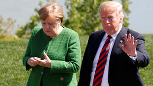 Angela Merkel y Donald Trump, 8 de junio 2018. REUTERS/Yves Herman