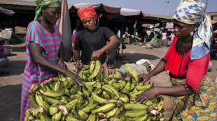 Informal workers Zenabu Abrahamanu (right) and Asetu Somana (left) sell bananas at Agbogbloshie Market