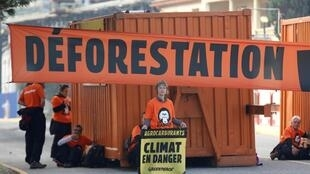 """Greenpeace activists block the entrance of the Total biodiesel refinery at La Mede near Fos-sur-Mer, France October 29, 2019 to denounce deforestation and the French government's responsability. The slogan reads """"Agrofuels, Climate in danger""""."""