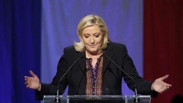 French National Front political party leader and candidate Marine Le Pen delivers a speech after results in the Nord-Pas-de-Calais-Picardie region for the second round of regional elections on Sunday.