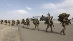 Des soldats américains se préparent à leur départ de leur base du Helmand, en octobre 2014.