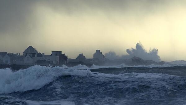 A wave breaks in Penmarch, Brittany, during high winds and unusually high tide coefficient
