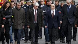 French Interior Minister Bernard Cazeneuve (2ndR) and Paris prosecutor Francois Molins (2ndL) arrive at the scene of a police raid in Saint-Denis, near Paris, November 18, 2015 after an operation to catch fugitives