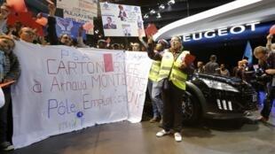 PSA Peugeot Citroën workers protest at job losses at last year's Paris motor show