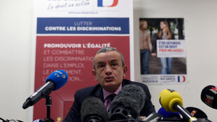 Slimane Laoufi of the French Defender of Rights, a consultative body in the fight against discrimination, addresses a press conference in Paris on 8 April, 2016